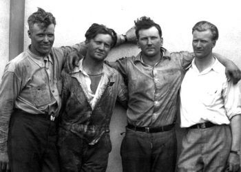 "The ""Four"" Hunter Bros."" at Sky Harbor Airport, Northbrook, Ill. Photo taken immediately after landing, July 4th, 1930. Left to righ: Albert, Kenneth, John, Walter"